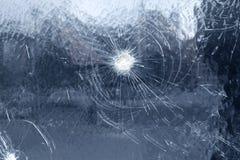 Gunshot. Detail of a gunshot through a window Stock Photography