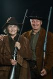 Gunslingers i västra plagg Royaltyfria Bilder