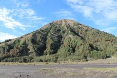 Gunung Batok is like a coconut shell. Mount Batok gives its own uniqueness if it is observed from a distance, it is similar to a coconut shell split into two stock photo