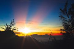 Gunung Bromo at dawn. Early morning after sunrise view of the spectacular Gunung Bromo and Sumeru volcanoes in Java, Indonesia Royalty Free Stock Photos