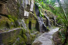 Gunung Kawi. Ancient carved in the stone temple with royal tombs. Bali, Indonesia. PANORAMA, long format.  stock images