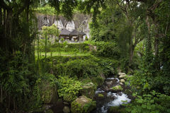 Gunung Kawi. Is an 11th-century temple complex in Tampaksiring north east of Ubud in Bali. It is located on the river Pakrisan.The complex comprises 10 rock-cut Stock Photos