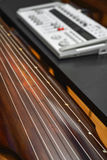 Guqin instrument. Recording chinesse music. Guqin string in focus Royalty Free Stock Images