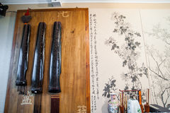Guqin on the wall in the room Stock Images