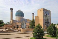 Gur-e-Amir in Samarkand city, Uzbekistan. The Gūr-i Amīr (Guri Amir) is a mausoleum of the Asian conqueror Tamerlane (also known as Timur). It occupies an Stock Photos