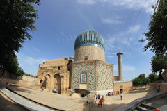 Gur-e-Amir in Samarkand city, Uzbekistan. The Gūr-i Amīr (Guri Amir) is a mausoleum of the Asian conqueror Tamerlane (also known as Timur). It occupies an Royalty Free Stock Photo