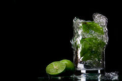 Gurgling and limes Stock Photography