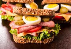Gurment sandwich. Big and tasty tost sandwich with sausage and eggs Stock Photos