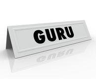 Guru Name Tent Card Expert Master Teacher Guide. Guru word on a white tent name card to illustrate a speaker or presenter has expertise and is a master, guide or Stock Photography