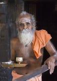 The guru at the Niruthi Shiva Lingam in Thiruvannamalai. THIRUVANNAMALAI, INDIA - OCTOBER 10, 2013: The guru at the Niruthi Shiva Lingam prepares the offering stock photo