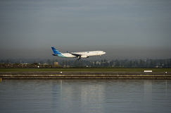 Garuda flight from Indonesia arrives Kingsford-Smith airport. Sydney Royalty Free Stock Images