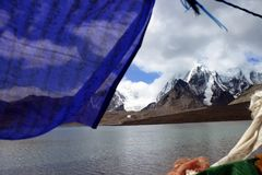 Gurudongmar Lake, North Sikkim, India. Gurudongmar Lake Buddhist Flag flutters in GuruDongmar Lake.JPG Buddhist Holy Lake -Gurudongmar Lake LocationNorth Sikkim stock photography