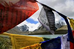 Gurudongmar Lake, North Sikkim, India. Gurudongmar Lake Buddhist Flag flutters in GuruDongmar Lake.JPG Buddhist Holy Lake -Gurudongmar Lake LocationNorth Sikkim royalty free stock photography