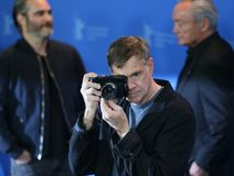 Gus Van Sant poses at the `Don`t Worry, He Won`t Get Far on Foot. ` photo call during the 68th Berlinale Film Festival Berlin at Hyatt Hotel on February 20, 2018 Stock Photo
