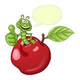 Gusano divertido de la historieta en manzana Foto de archivo libre de regalías