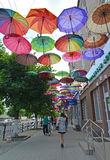 GUSEV, RUSSIA - JUNE 04, 2015: Color umbrellas hang over the sid Stock Photography