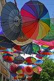 GUSEV, RUSSIA - JUNE 04, 2015: Color umbrellas hang on the stree Stock Images