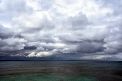 Gushing sea on a cloudy day. Stock Image