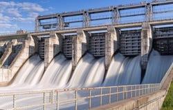 Gushing water through industrial dam Stock Image