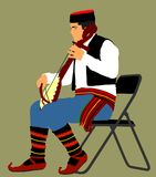 Guslar play gusle, traditional music instrument from Montenegro and Balkan. Balkan music player and singer . Guslar play gusle, traditional music instrument Royalty Free Stock Photos