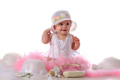 Gussied Up. A beautiful baby girl gussied up in girly-girl accessories.  Isolated on white Stock Images