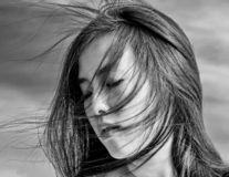 Gust of wind blows hair over face royalty free stock images