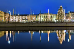 Gustaf Adolf's square with Christmas decoration in Gothenburg. Gustaf Adolf's square in Gothenburg in the evening, decorated for Christmas and reflecting in the royalty free stock photo