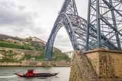Gustave Eiffel Maria Pia railway bridge Douro river Porto Oporto tourist boat Royalty Free Stock Photos