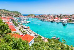 Gustavia harbor, St Barts, Caribbean. Bright and colorful image with luxury yachts and boats in the Harbor of Saint Barthelemy, St Barts royalty free stock photo