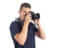 Gut aussehender Mann, der eine Fotografie mit einer slr Kamera nimmt Lizenzfreie Stockfotografie
