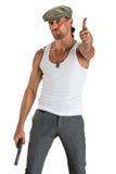 Gut aussehender Mann in der Kappe mit einem Gewehr Stockfoto