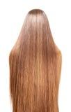 Gut-gepflegtes braunes langes Haar, das zurück Frau lokalisiert auf Weiß fließt Lizenzfreie Stockfotos
