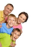 Gute Familie in hellem Stockfotografie