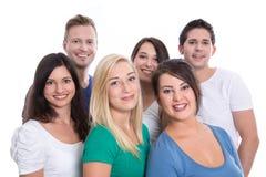 Gute Teamarbeit - glückliche lokalisierte Jugendliche - Frau und Mann - auf w Stockfotografie
