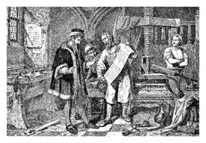 Gutemberg working in his print workshop Stock Image