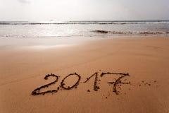 Guten Rutsch ins Neue Jahr 2017 auf dem Strand Lizenzfreies Stockfoto