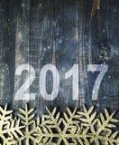 Guten Rutsch ins Neue Jahr 2017 auf einem hölzernen Hintergrund Nr. 2017 auf Weinleseart Lizenzfreie Stockfotos