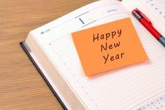 Guten Rutsch ins Neue Jahr auf einem Organisator 2016 des neuen Jahres Stockfoto