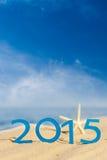 Guten Rutsch ins Neue Jahr 2015 auf sandigem Strand Lizenzfreies Stockfoto