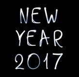 Guten Rutsch ins Neue Jahr 2017 auf schwarzem Hintergrund Lizenzfreies Stockbild