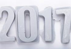 Guten Rutsch ins Neue Jahr 2017 auf weißem bacground Zahlen des Mastixes oder des Betrugs Lizenzfreie Stockfotos