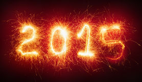 Guten Rutsch ins Neue Jahr, brennende Zahlen Lizenzfreies Stockbild