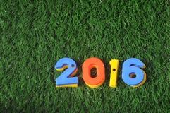Guten Rutsch ins Neue Jahr 2016, bunte Zahlidee Stockfotografie