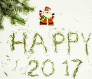 Guten Rutsch ins Neue Jahr-Design auf weißem Hintergrund mit Kiefer und Text Lizenzfreie Stockbilder