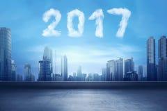 Guten Rutsch ins Neue Jahr durch Zahlen der Wolkenform 2017 Lizenzfreie Stockbilder