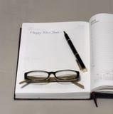 Guten Rutsch ins Neue Jahr geschrieben auf eine Tagebuchseite Lizenzfreie Stockfotos