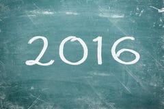 Guten Rutsch ins Neue Jahr 2016 geschrieben auf Tafel Stockbild