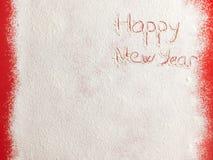 Guten Rutsch ins Neue Jahr geschrieben auf weißen Schnee Stockbild