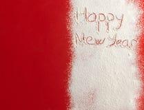 Guten Rutsch ins Neue Jahr geschrieben auf weißen Schnee Stockbilder