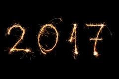 GUTEN RUTSCH INS NEUE JAHR 2017 geschrieben mit Feuerwerken als Hintergrund Stockbild